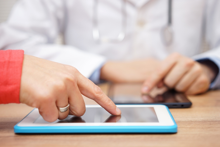 doctor sends test results to patient on tablet