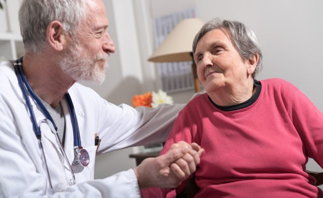 doctor comforting older patient