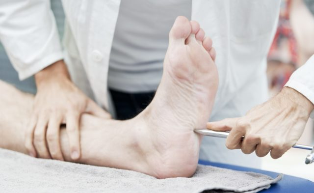 doctor holding foot