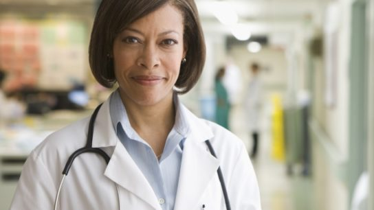 Female physician standing in a hospital