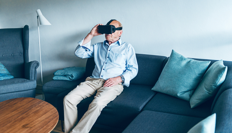 Male with virtual reality goggles.