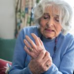 older woman with hand OA