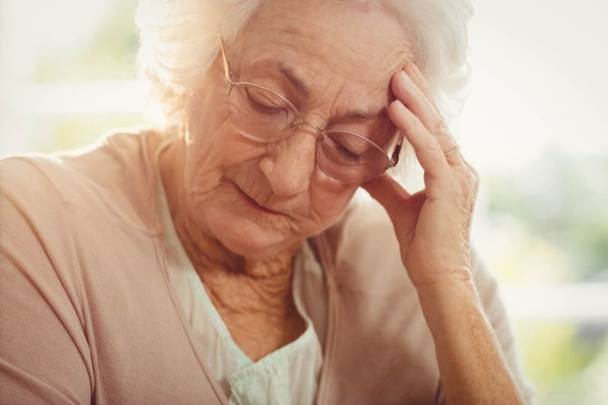 Elderly woman with a headache.