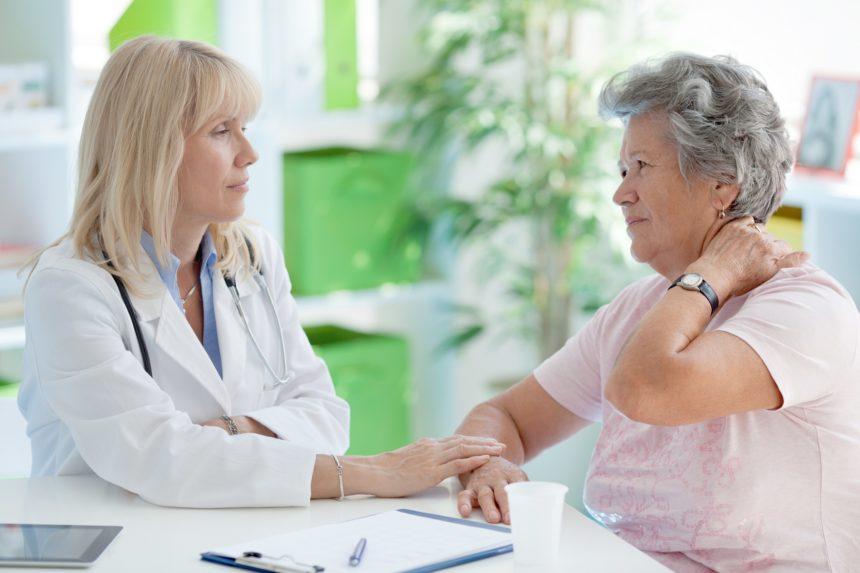 senior woman talking to doctor