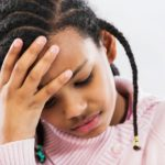 A young girl with a headache