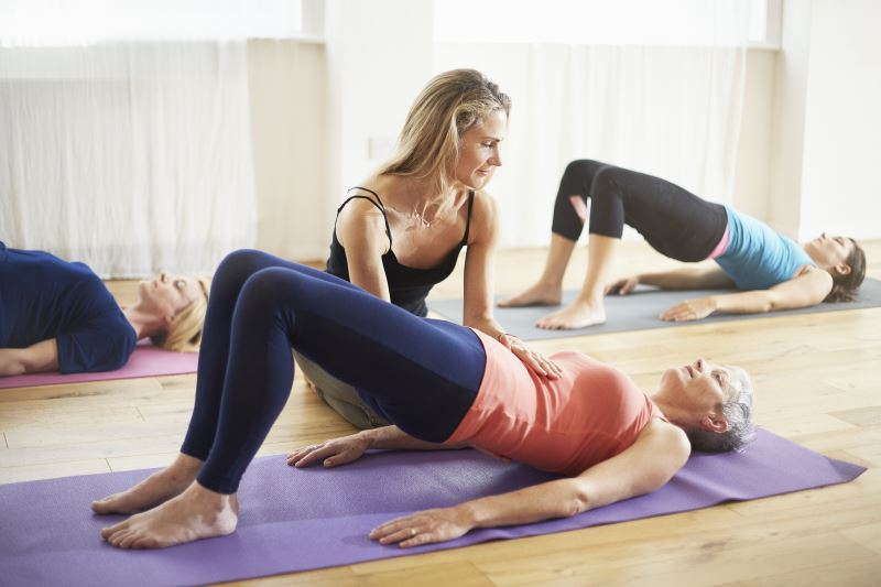 Women performing pilates.
