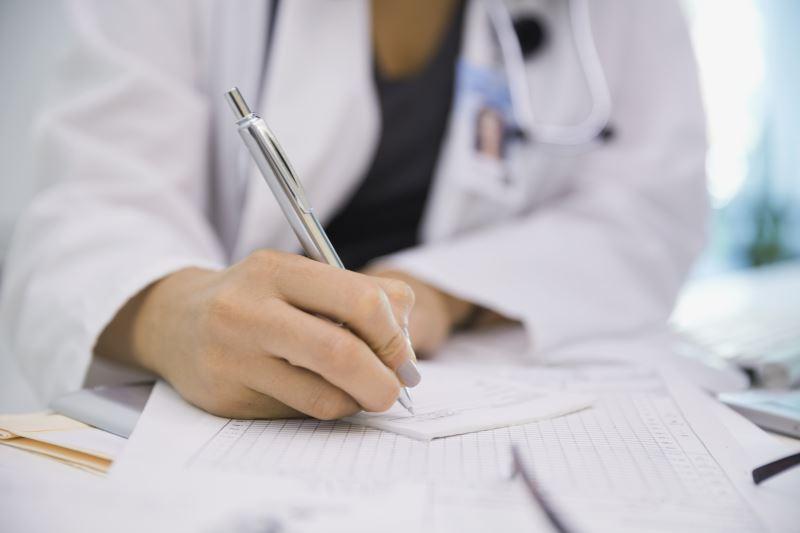 A physician writing a prescription