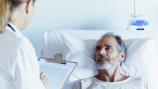 doctor writing notes from patient