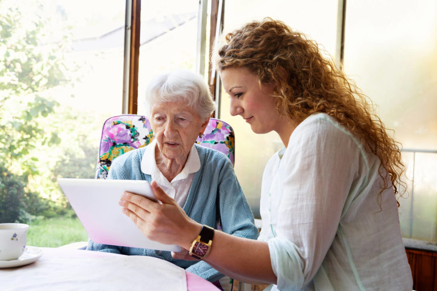 A caregiver reviews a patient's daily therapy.
