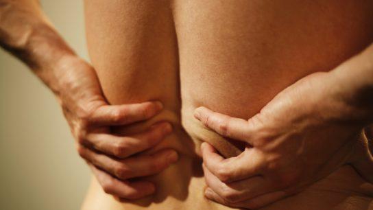 man massaging lower back, back pain