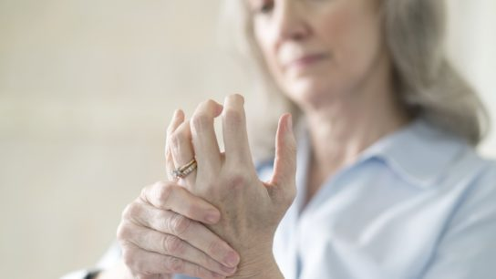 Senior woman with joint pain in her hand